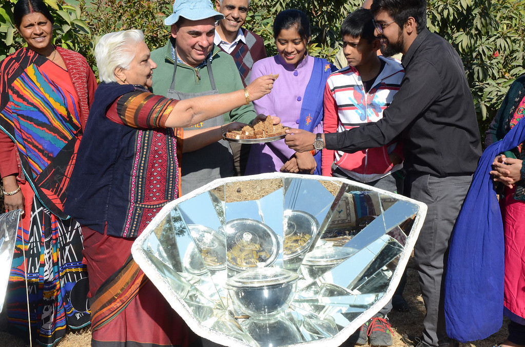 Janak McGilligan offers sample of solar cooked dish.
