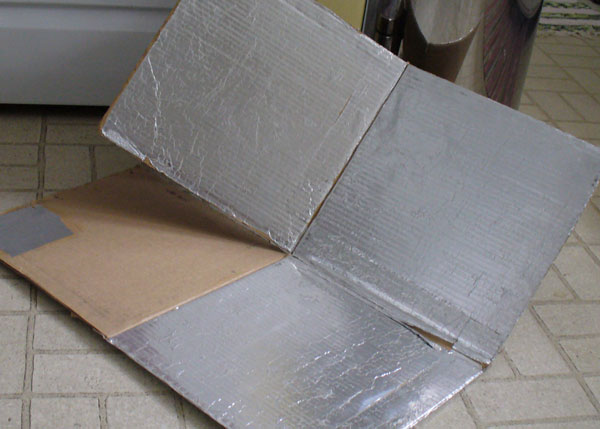 image of solar cooker partly folded.